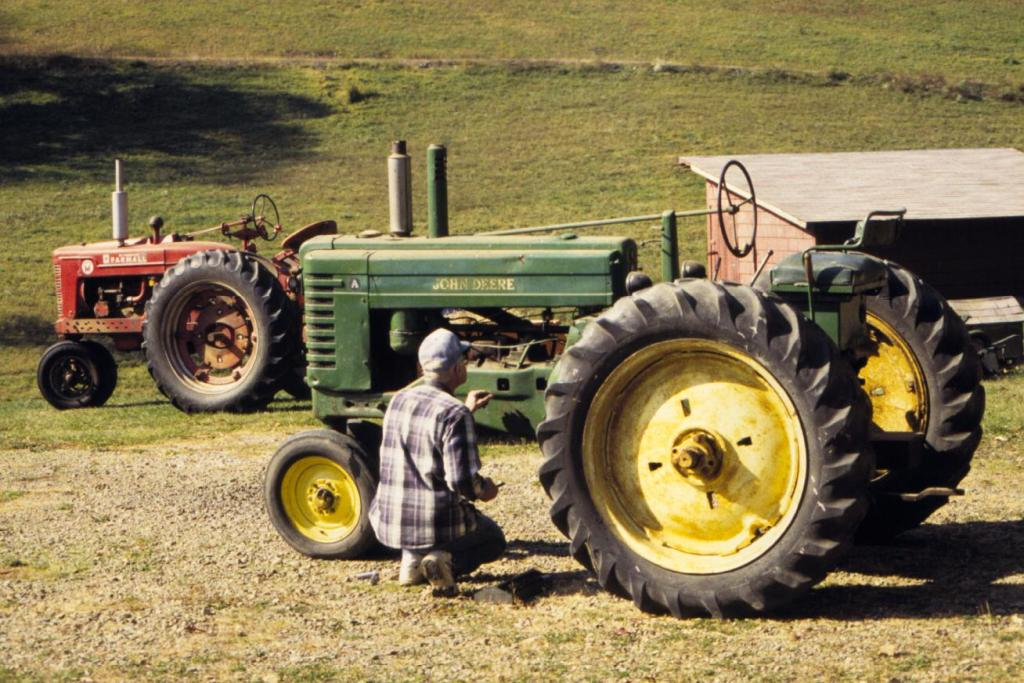 Farmer On Tractor : Tractors on the farm